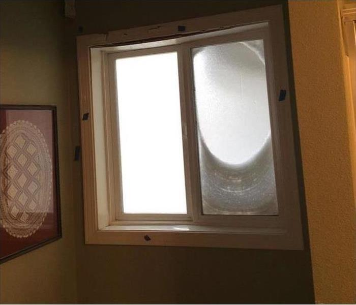 double-framed window with apparent water damage on the wall