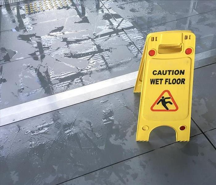 yellow wet floor sign in lobby