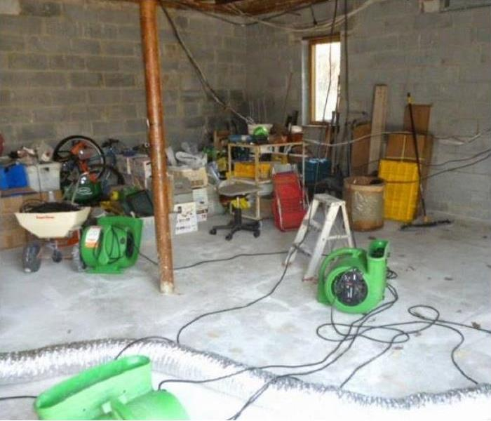 SERVPRO drying being used in water damaged basement