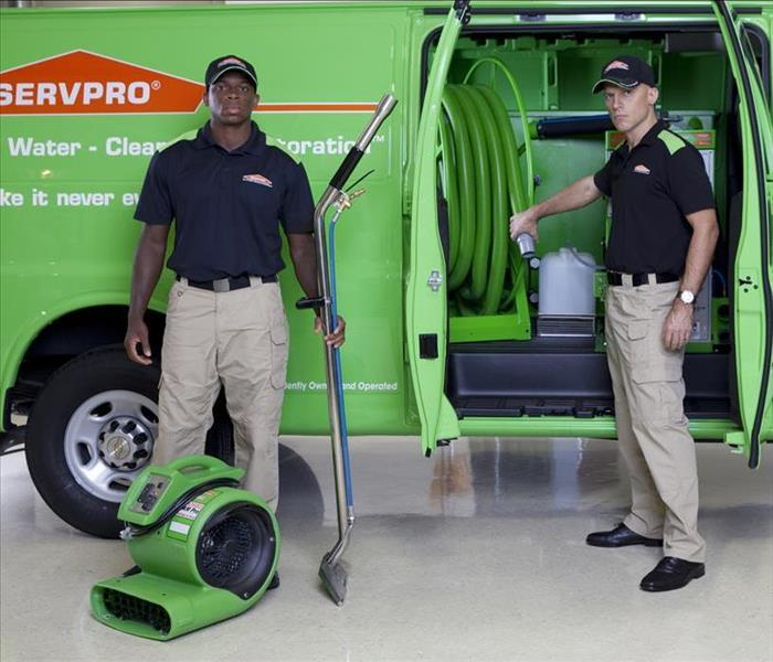 SERVPRO Techs standing with equipment by SERVPRO van