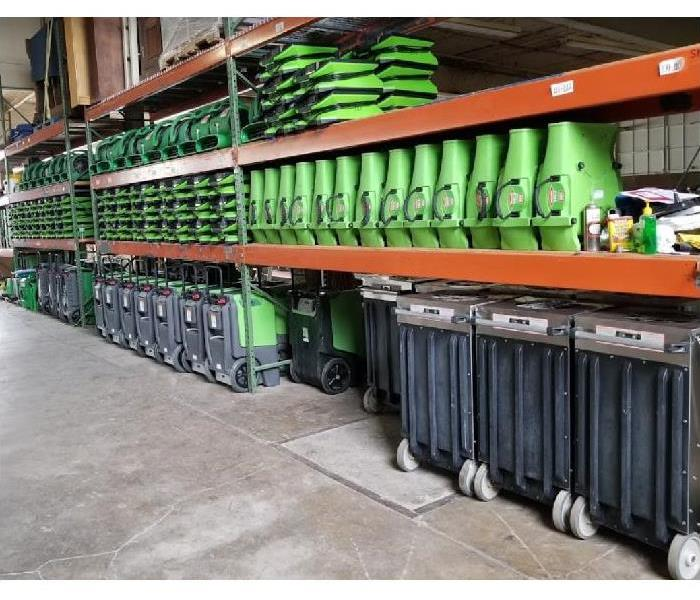 SERVPRO drying equipment stacked inside of storage facility